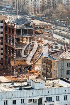 demolition of old apartment house on urban street in Moscow