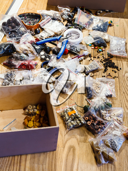 findings for beads making on table in workshop