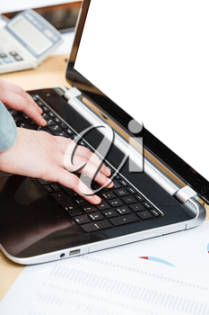 business workflow - businessman working with laptop with cut out screen at office table