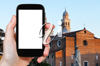 travel concept - tourist photograph view of Basilica of S.Giustina in Padua from Prato della Valle, Italy on smartphone with cut out screen with blank place for advertising logo