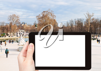 travel concept - tourist photograph Grand Basin Octagonal in Tuileries Garden, Paris, France on tablet pc with cut out screen with blank place for advertising logo