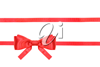 one red satin bow in lower left corner and two horizontal ribbons isolated on horizontal white background
