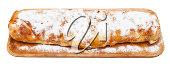 typical austrian dessert apple strudel on wooden board isolated on white background