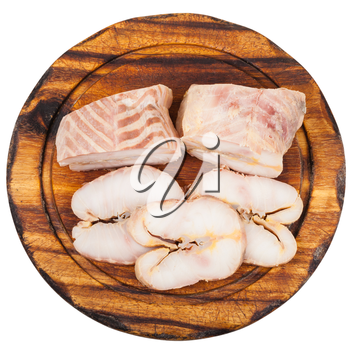 top view of pieces and slices of hot smoked Starry sturgeon and sturgeon fishes on wooden cutting board isolated on white background