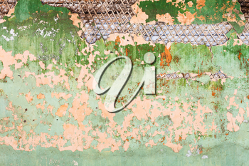 background from peeling paint on wall of old wooden house