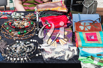 table with accessories, jewelry, bags, scarves at the fair