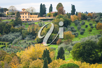 travel to Italy - above view of green and yellow gardens in outskirts of Florence city from Piazzale Michelangelo in Florence city in autumn