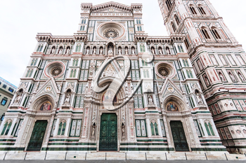 travel to Italy - Florence Duomo Cathedral (Cattedrale Santa Maria del Fiore, Duomo di Firenze, Cathedral of Saint Mary of the Flowers) and Giotto's Campanile on Piazza San Giovanni in morning