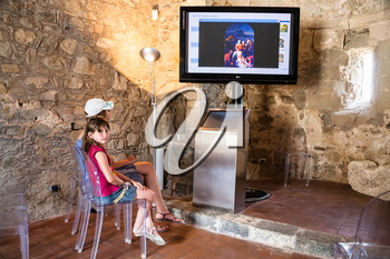 CALATABIANO, ITALY - JULY 5, 2011: children in ancient arabic - norman - byzantine castle in Sicily. Calatabiano Castle was founded by the Arabs, who moved from Calatabiano to conquer Taormina in 902
