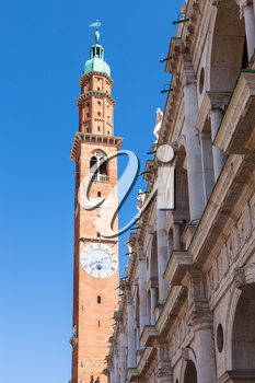 travel to Italy - clock tower (torre della bissara) of Basilica Palladiana in Vicenza city in spring
