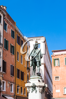 travel to Italy - bronze sculpture of Carlo Goldoni on Campo San Bartolomeo in Venice city in spring