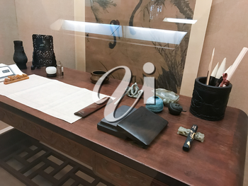 GUANGZHOU, CHINA - MARCH 31, 2017: clerk's desk in interior of Chen Clan Ancestral Hall (Guangdong Folk Art Museum) in Guangzhou city. The house was prepared for imperial examinations in 1894