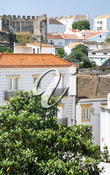 Travel to Algarve Portugal - view of residenial houses and Castle in Tavira city