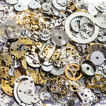 watchmaker workshop - pile of used watch spare parts close up