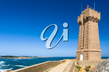 travel to France - edifice of Mean Ruz lighthouse in Ploumanac'h site on English Channe coast in Perros-Guirec commune on Pink Granite Coast of Cotes-d'Armor department of Brittany in sunny day
