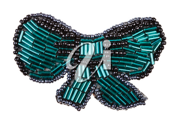 hand crafted bow tie shaped brooch from glass green bugles and black beads isolated on white background