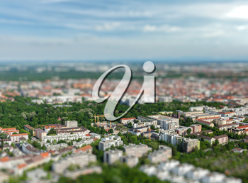 Aerial view of Munich from Olympiaturm Olympic Tower with tilt shift toy effect shallow depth of field. Munich, Bavaria, Germany