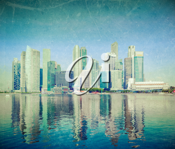 Modern city skyline of business district downtown of Singapore in day  with grunge texture overlaid