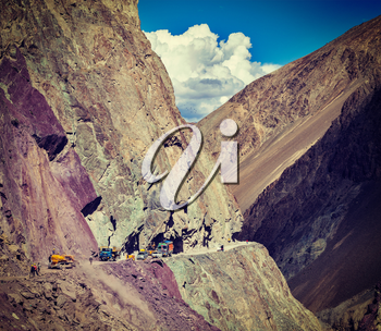 Vintage retro effect filtered hipster style travel image of Road construction in Himalayas. Ladakh, Jammu and Kashmir, India