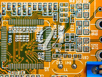Electronic microcircuit taken closeup suitable as background.