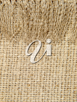 Natural linen texture pattern with fringe suitable as background.