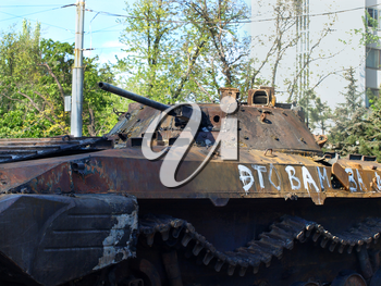 MARIUPOL,UKRAINE-MAY 09,2014:Destroyed armored car on Mariupol street taken closeup after armed conflict.