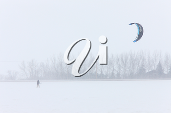 Parachute and Snow Boarding in Blizzard