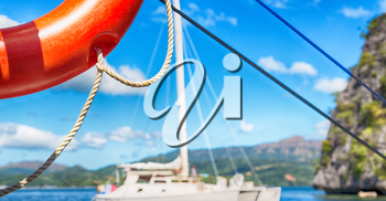 blur  in  philippines   a buoy in boat neat the pacific ocean bokeh and mountain background