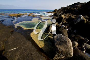 landscape rock stone sky cloud beach   water  in lanzarote spain isle