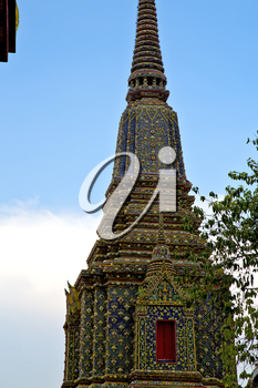 bangkok in   temple  thailand abstract cross colors roof  wat  palaces   asia sky   and  colors religion mosaic rain