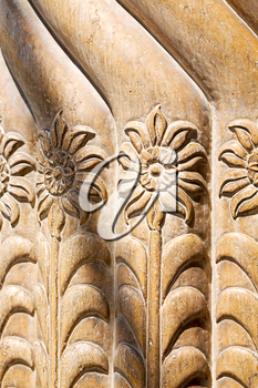 in old iran mousque the column  incision of a flower like abstract background