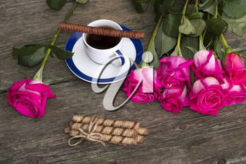 still life pink roses row coffee and cookies
