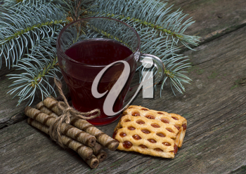 the glass of drink decorated with a fir-tree branch