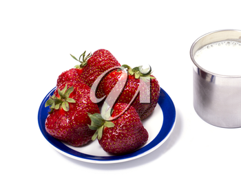 strawberry on a saucer and a steel mug of milk, a berry subject