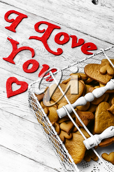 Wicker basket with cookies and the inscription in love