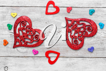 Valentine symbolic heart of buttons on bright background.