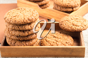 Close-up view on oat biscuits in wooden boxes with a shallow depth of field