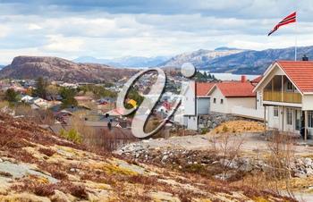 Rorvik. Fishing Norwegian town with colorful wooden houses on rocky hills