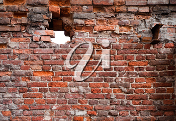 Vintage detailed brick wall texture with hole
