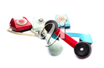 Set of vintage telephones with twisted handsets