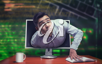 Surprised businessman getting out from the computer screen