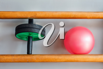 Crossfit equipment: ab roller and ball on the shelf