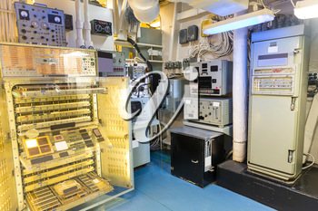 Military ship electric room with gauge, switches, indications and control panel.