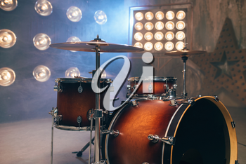 Drum-kit, drum-set, percussion instrument, drumkit on the stage with lights, nobody. Drummer professional equipment, beat set