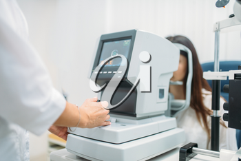 Computer diagnostics of vision, professional choice of eyeglasses. Eyesight test in optician cabinet. Patient and doctor, eye care consultation, glasses diopter selection