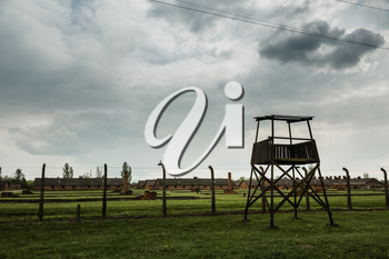 Watchtower and barbed wire fence, German concentration camp Auschwitz II, Poland. Museum of victims of the nazi genocide of the Jewish people