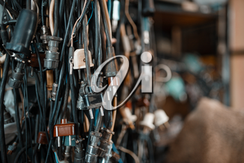 Bunch of wires with different plugs, nobody. Electrical testing tools in laboratory closeup. Lab equipment, engineering workshop