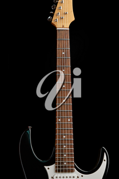 Electric guitar isolated on black. String musical instrument, electro sound, electronic music, equipment for stage concert