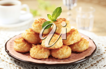 Stack of coconut macaroons on a decorative plate
