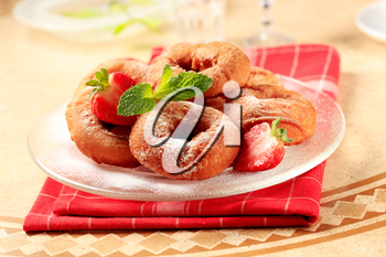 Deep-fried ring-shaped donuts